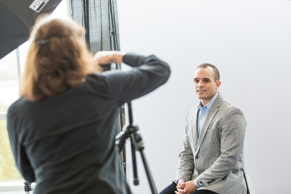 man getting a headshot taken for professional photos